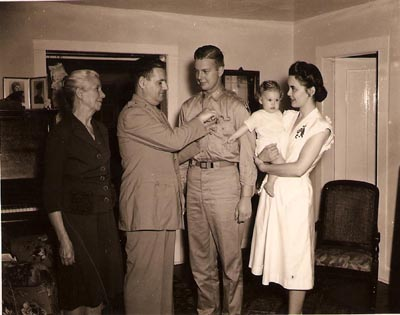 Ossian Seipel receiving military medal after returning to the United States
